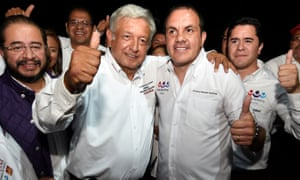 Presidential candidate Andres Manuel Lopez Obrador (left) poses with  Cuauhtémoc Blanco during a campaign rally