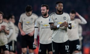 Manchester United players react after their Premier League defeat at Anfield.