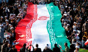 Pro-government demonstrators wave their national flag during a march in Iran's holy city of Qom