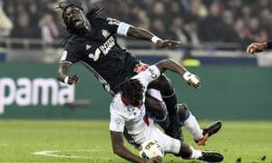 Marseille's Bafetimbi Gomis is tackled by Mapou Yanga-Mbiwa during Lyon's Ligue 1 win on Sunday.