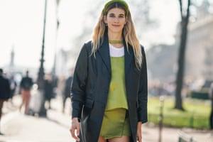 Veronika Heilbrunner wears her green Prada headband at Paris fashion week in February.