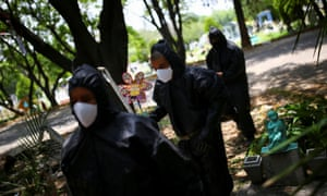 Gravediggers at San Isidro cemetery in Mexico City are seen before they start digging new graves, as the coronavirus outbreak continues in Mexico, 29 June 2020.