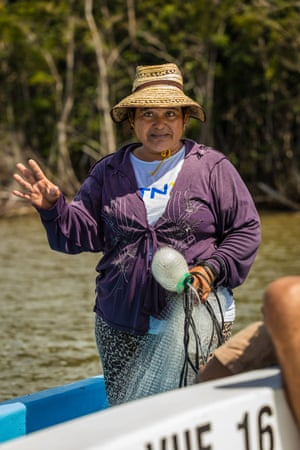 Anselma Cabrera, cast-netting for shrimp, off Toledo. She and her husband have been fishing in these waters for more than 30 years and accept the rules that require all fishers to have licences and record their catch. Some people don't see why the should to pay for a licence and it can be complicated to get one but this is the way to make sure there is enough [fish] for everyone.'