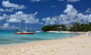 Paradise Beach, Barbados, with sailing yachts and people on the beach