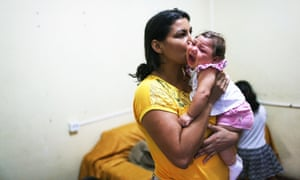 Jusikelly da Silva holds her 7-month-old daughter Luhandra, who was born with microcephaly