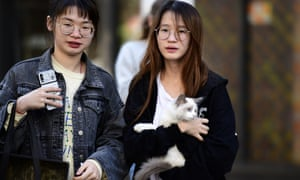 Residents wait outside the Mascot Towers building in Sydney