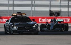 The safety car leads Hamilton.