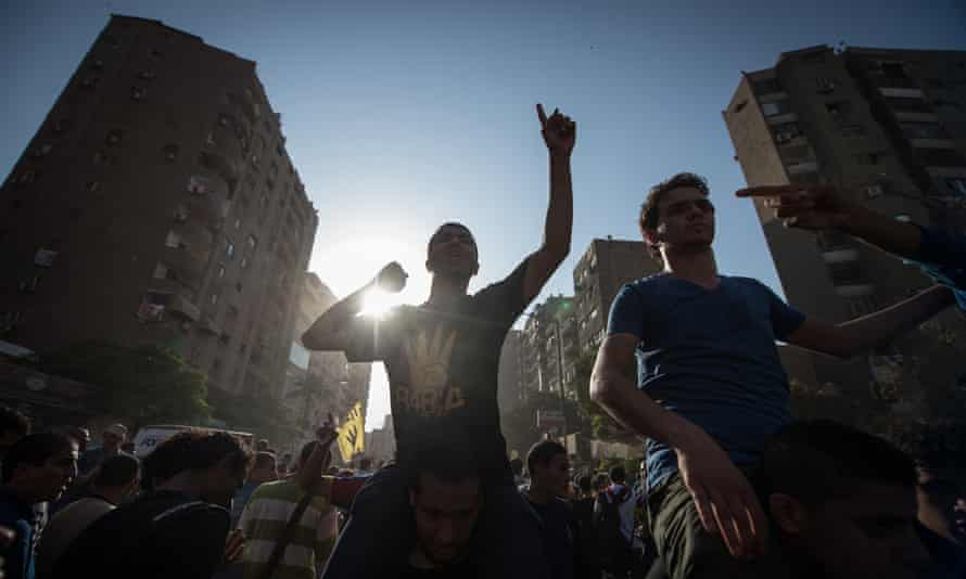 Supporters of the Muslim Brotherhood in Cairo in 2013. The UAE has threatened to block arms deals with the UK if they do not act against the group.