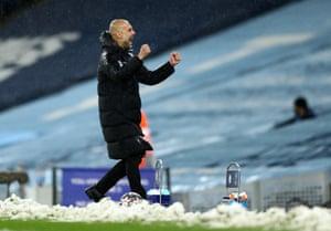 Pep Guardiola celebrates.