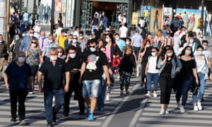 People wear protective face masks to curb the spread of coronavirus in Kizilay Square, Ankara, 24 June 2020.
