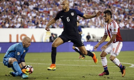 Brad Guzan, left, and John Brooks (center) helped the US keep Paraguay at bay on Saturday night