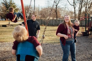Jessica Rebeschini, 26, and her husband Ron, 34, with her sons Chase, Karter and Brody, at a park near their home in Boundurant, Iowa, on 22 December 2019.
