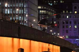 An emergency response helicopter lands on London Bridge.