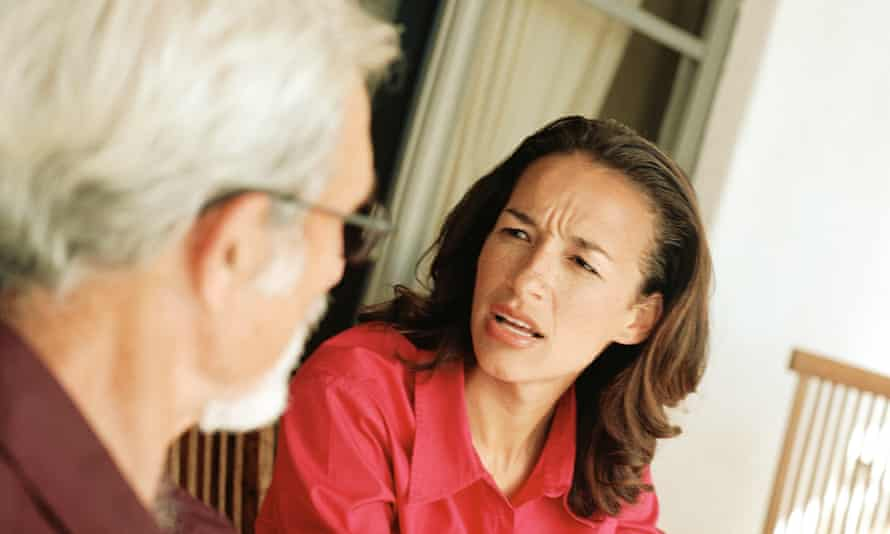 Woman speaking with senior man