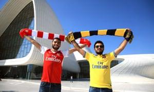 Arsenal fans pose outside the Heydar Aliyev Center in Baku.