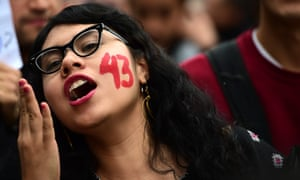 Students and relatives of the 43 missing students from Ayotzinapa take part during a protest in Mexico city, on Saturday.