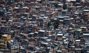 An aerial view of Rocinha in Rio de Janeiro. The tourists who drive through in jeeps and take photographs of residents without asking permission are not universally popular with residents.