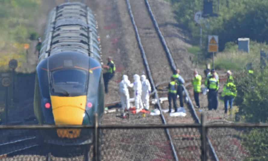 Police and rail accident investigators attend the scene near Port Talbot where Gareth Delbridge, 64, and Michael Lewis, 58, were killed.