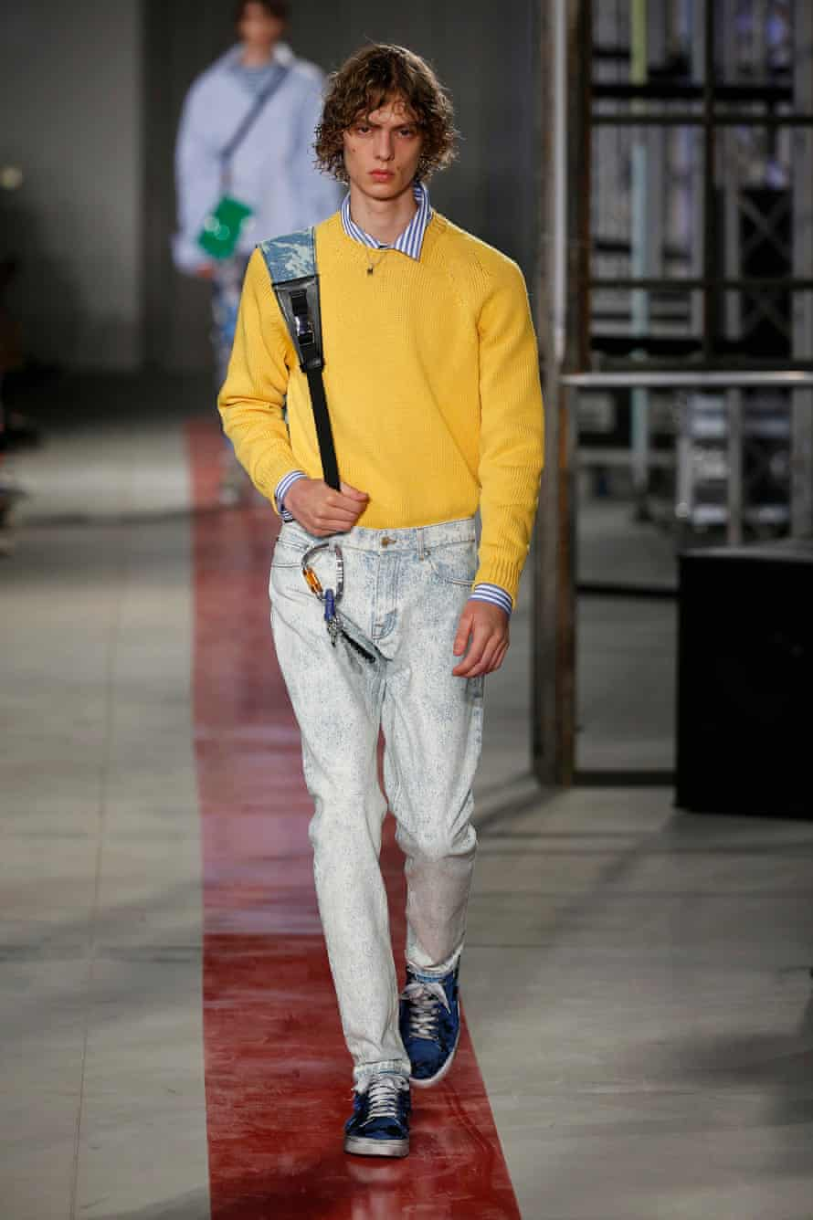 A model on the catwalk at the MSGM show during Milan men's fashion week, June 2016, demonstrates the man tuck