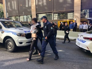 Sydney, Australia: A man is arrested on York Street in the central business district shortly after two women were stabbed, one of whom died