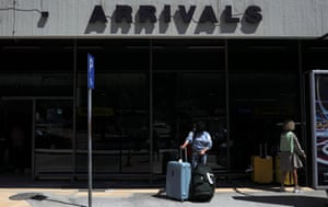 A passenger from Germany stands outside Rhodes airport after the lifting of travel restrictions.