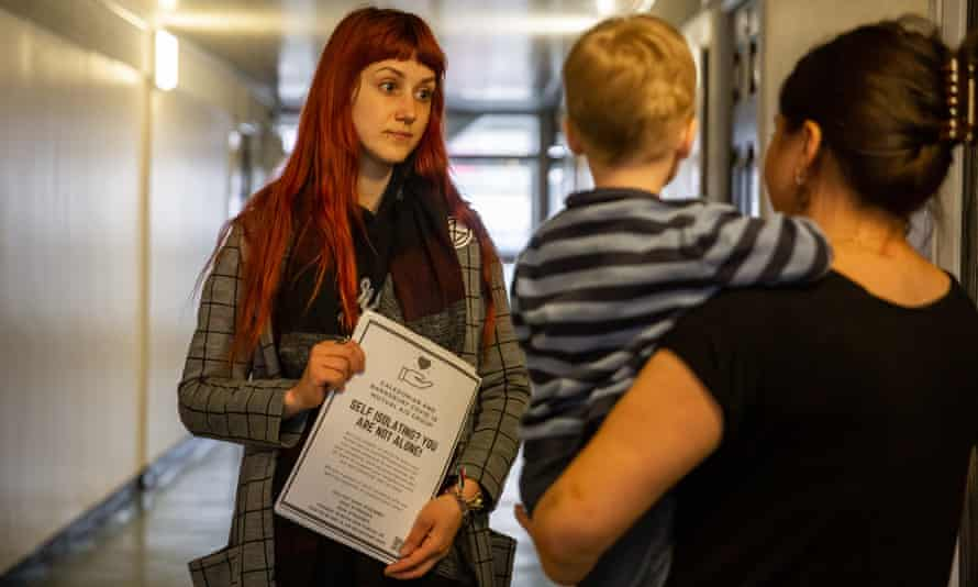 Mutual Aid volunteer Jessica Kleczka talks to a woman in London about childcare provision in the event of school closures before lockdown in March.