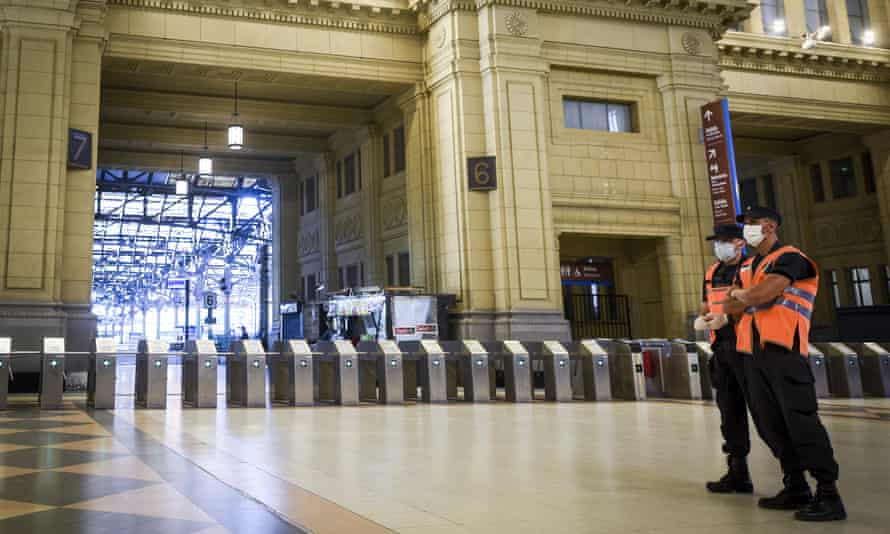 police men in an empty train station in Argentina
