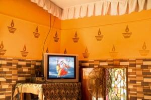 Radha and Krishna on the television at Mauni Baba Ashram near Neel- kanth, India, May 20, 2016.