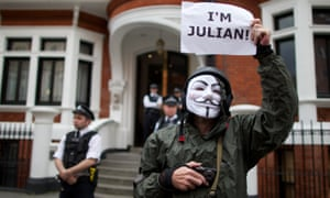 A supporter of Julian Assange stands outside the Ecuadorian embassy in London on August 16, 2012.