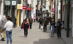 Shoppers in Douglas on the Isle of Man, where lockdown restrictions on non-essential retail shops have already been lifted.