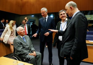 From left, German Finance Minister, Wolfgang Schaeuble (seated), French Economy Finance Trade Minister, Bruno Lemaire, Greek Finance Minister Eucleidis Tsakalotos and Pierre Moscovici, European Commissioner for Economic and Financial Affairs, Taxation and Custom (pointing), at the start of the Eurogroup Finance Ministers meeting.