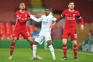 Liverpool's Fabinho (left) and Andrew Robertson keep tabs on Real Madrid's Rodrygo.