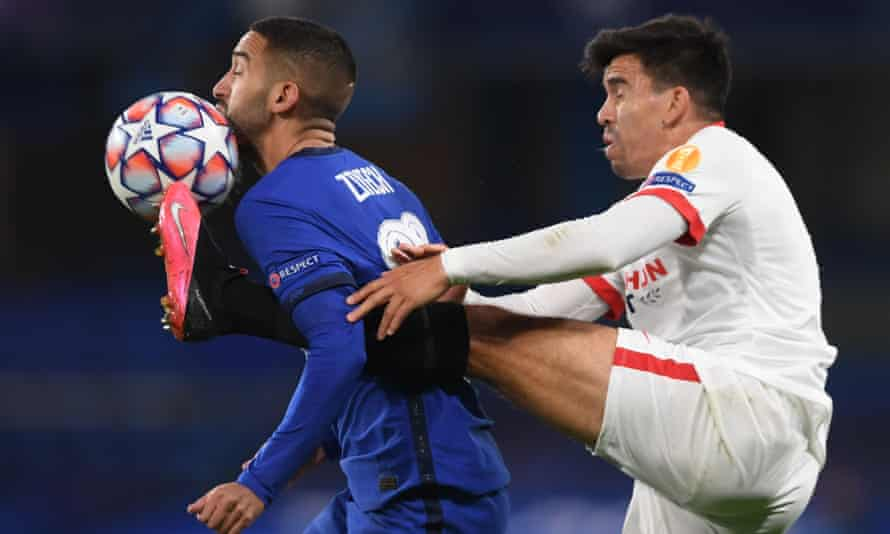 Hakim Ziyech braves the close attentions of Sevilla's Marcos Acuña