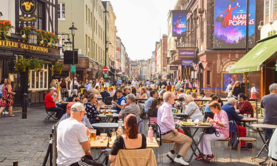 People outside restaurants and cafes in Old Compton Street, London