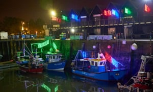 Aldeburgh cancelled this year's switch-on while the harbour at Whitstable, pictured above in 2017, has no lights at all this year.