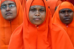 Kolkata, India Hindu nuns sit during a rally to mark the International Women's Day