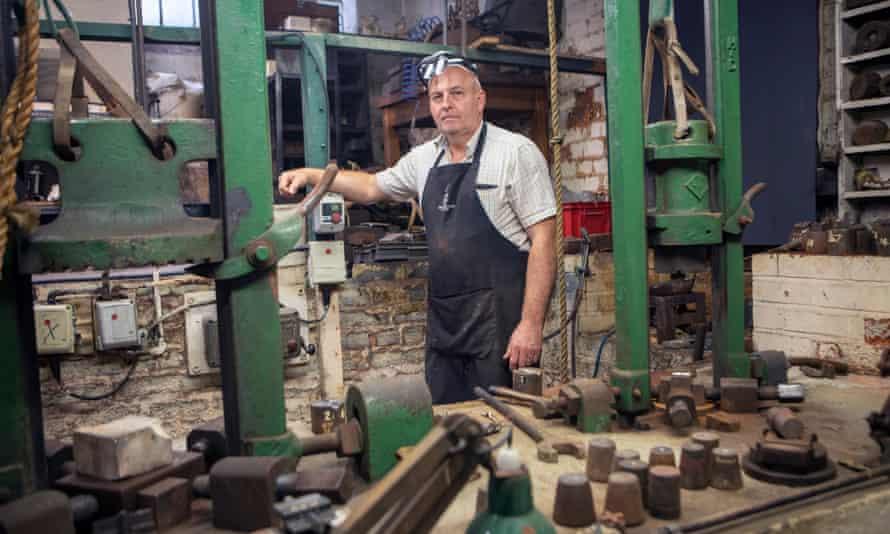 Nigel Ellis in a Deakin & Francis workshop, surrounded by tools