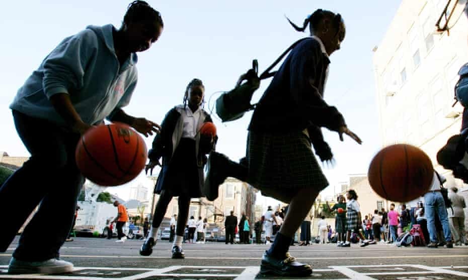 Students play in the school yard on their first day of school at Cathedral Academy on 17 October 2005. The Catholic elementary school was the first school to reopen in the French Quarter after Hurricane Katrina.