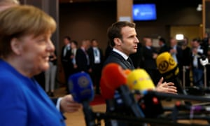 German chancellor Angela Merkel and French president Emmanuel Macron talking to the media as they arrived at the summit.