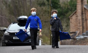 Children walking to school wearing smog pollution masks in Britain. Residents in many developing countries are exposed to toxic air both outdoors and inside their homes.