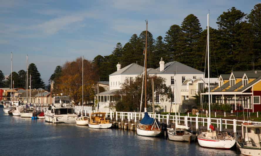 A line of boats and historic houses in Port Fairy
