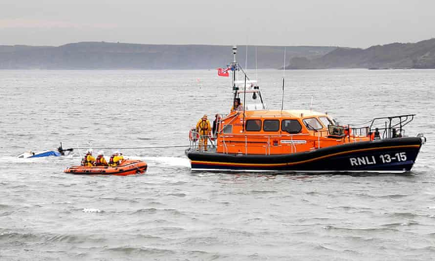 Don't Panic is towed by a lifeboat after it was found off Scarborough's West Pier.