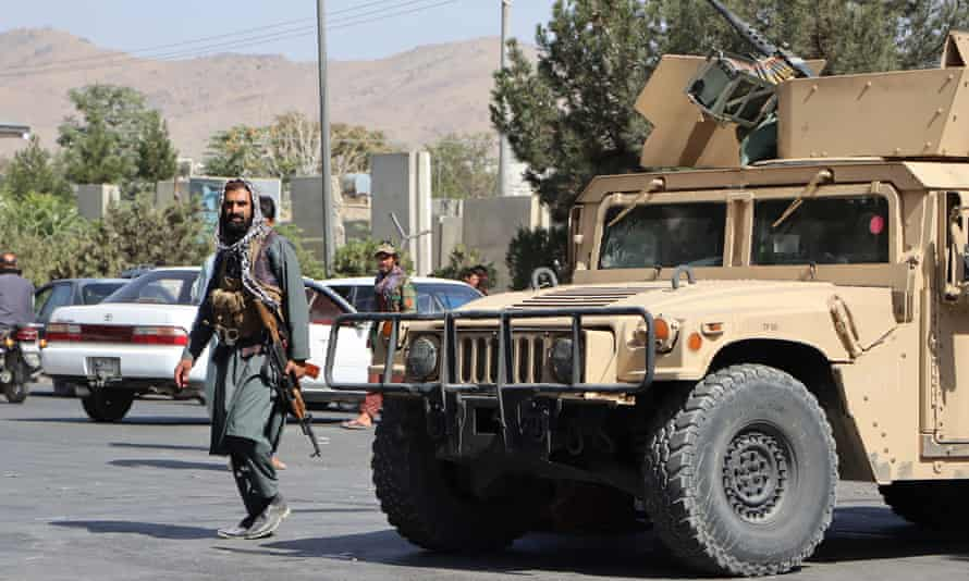 Taliban fighters block the road to Kabul airport
