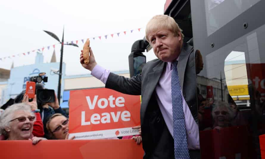 Boris Johnson holds a Cornish pasty as he boards the Vote Leave campaign bus in Truro, Cornwall.