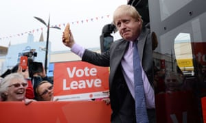 Boris Johnson holds a Cornish pasty as he boards the Vote Leave campaign bus in Truro