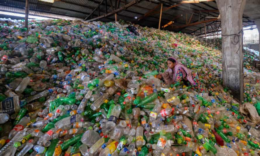 A worker sorts used plastic bottles in a recycling factory in Dhaka, Bangladesh.
