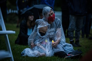 Crowds gather in the rain at the Invasion Day dawn service in King's Domain in Melbourne