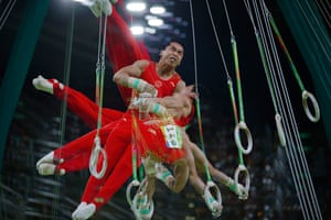 Day tenYou Hao of China dismounts during the men's rings apparatus final at the Rio Olympic Arena in Barra Olympic Park