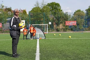 Football Association referee Jawahir Roble oversees a girls' training session