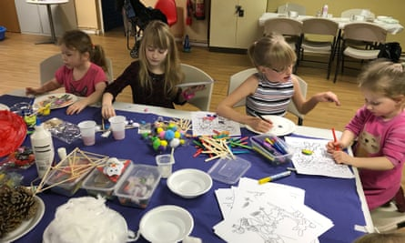Children take part in art activities at the Neo holiday club in Birkenhead, Merseyside
